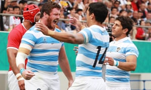 Argentina players celebrating after scoring a try