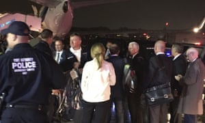 Pence talks on the tarmac at LaGuardia.