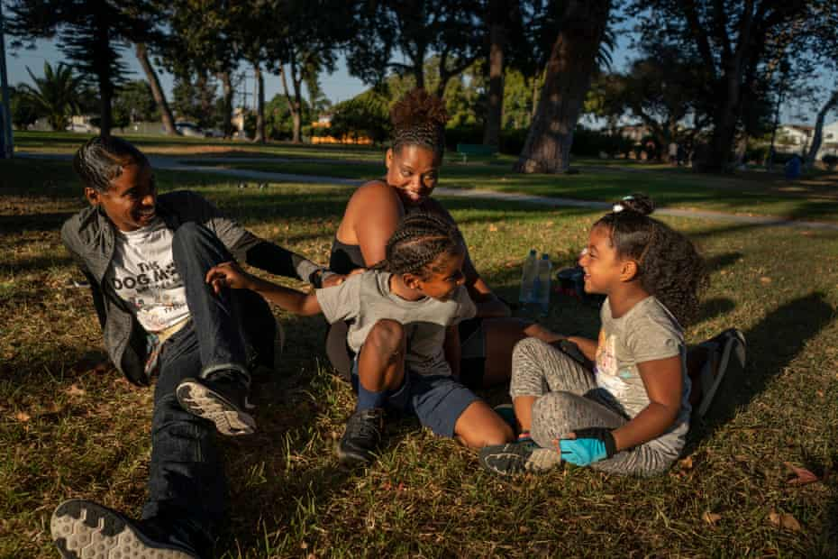 Cherokeena Robinson, 32, and her sister Lina Robinson, 34, meet at the park in Torrance, California almost every day to let their kids play together.