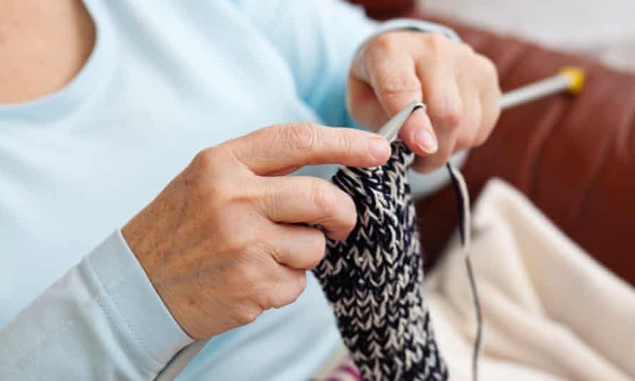 Older woman knitting