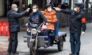 Coronavirus latest news and live updates: Security guards take temperature readings at a seafood market in Guangzhou. China's death toll has passed 630 with more than 30,000 confirmed cases.