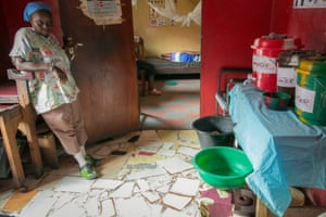 Anita Fakoli, in the main room at the clinic with buckets of soapy water, chlorine water and clean water