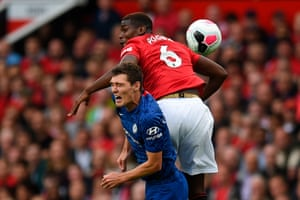 Pogba catches Christensen with his elbow.