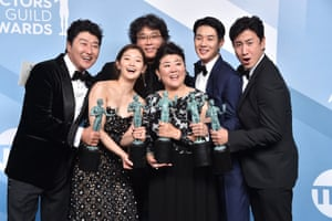 Parasite's Song Kang-ho, So-dam Park, director Bong Joon-ho, Jeong-eun Lee, Woo-sik Choi, and Sun-kyun Lee – winners of outstanding performance by a cast in a motion picture – pose in the press room