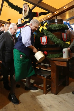 Dieter Reiter, the mayor of Munich, starts Oktoberfest by tapping the first barrel of beer