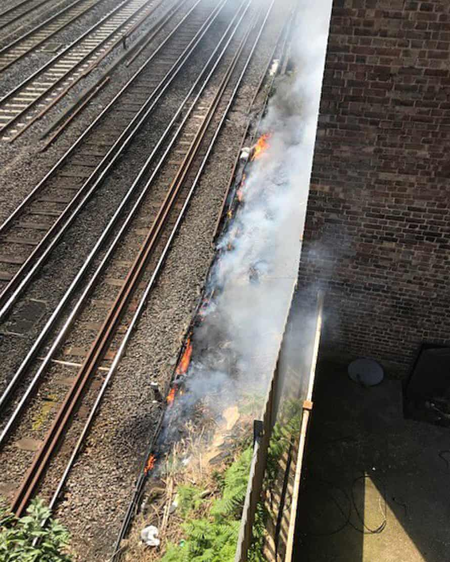 Network Rail photo of the fire next to the tracks near South Hampstead in London.