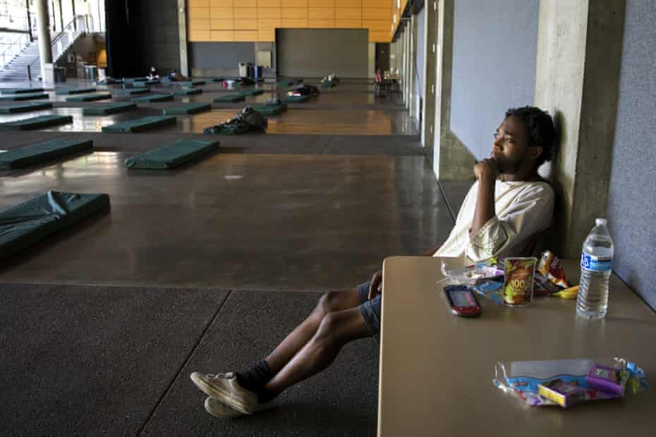 A man rests in the cooling center at Fisher Pavilion in the Seattle Center this week after experiencing symptoms of heat exhaustion.