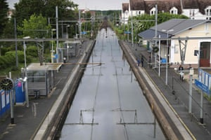 Souppes-sur-Loing, southeast of Paris People stand next to flooded railway track