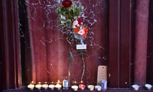 Tributes left in the window of one of the restaurants attacked in Paris in November.
