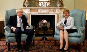 Boris Johnson poses for a photograph with Nicola Sturgeon at Bute House in Edinburgh.