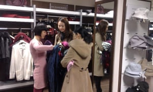 Shoppers at Burberry's discount outley in Hackney, east London