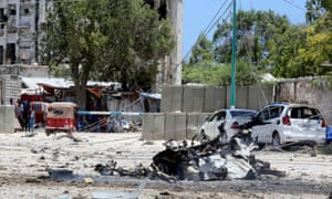 The scene of a suicide explosion after gunmen stormed a government building in Mogadishu.