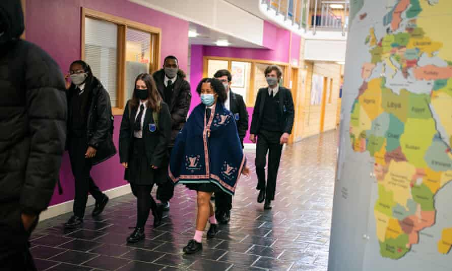 Children arrive at Oasis Academy Shirley Park in Croydon, south London