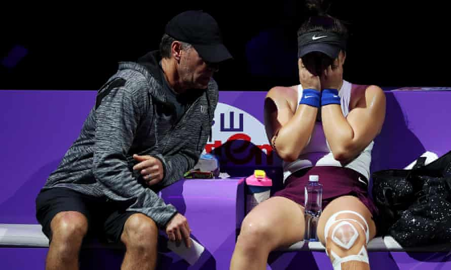 Bianca Andreescu speaks to her coach, Sylvain Bruneau, after sustaining an injury to her left leg at Shenzhen in October 2019
