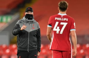 Juergen Klopp congratulates Nathaniel Phillips after the match.