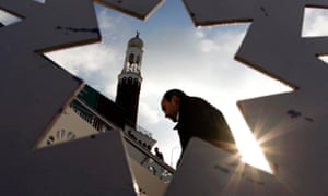A man arrives at mosque for Friday prayers