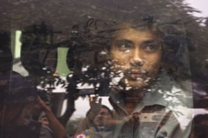 Reuters reporter Kyaw Soe Oo leaves a court where he was remanded for flying a drone in Yangon, Myanmar