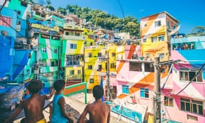 Boys playing with kites in a favela in Brazil
