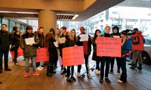 Protesters stand outside a Vancouver courtroom on 20 January 2020.