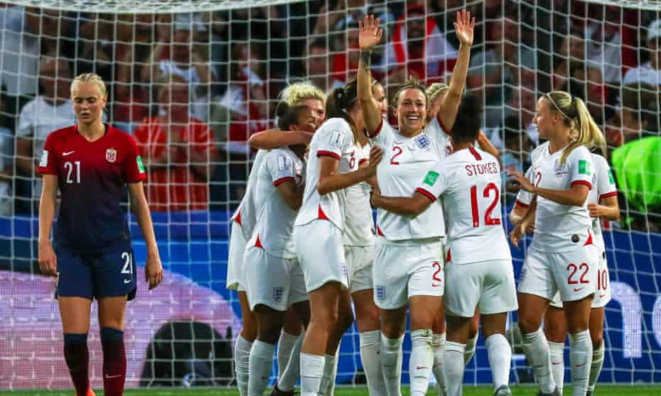 Lucy Bronze celebrates with her England teammates after scoring the third goal against Norway in the quarter-final.