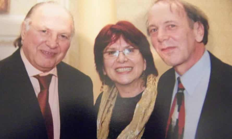 Tim Wilkinson, right, with his wife, Irén, and the writer Imre Kertész at the Hungarian embassy, London, 2006
