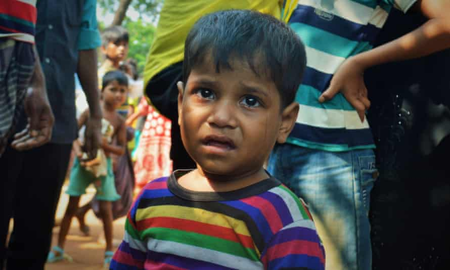 A Rohingya boy is brought to a lost-and-found booth in Kutupalong camp, Cox's Bazar, Bangladesh.