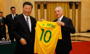 President Michel Temer of Brazil, right, presents China's president, Xi Jinping, with a Brazilian football jersey signed by Pelé before the start of their bilateral meeting in September 2017 in Beijing.