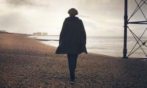 lady walking on a beach