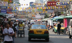 A canopy of signs: Khao San Road in Bangkok.