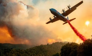 An aircraft drops fire retardant on a ridge during the Walbridge fire, part of the larger LNU Lightning Complex fire, in Healdsburg, California, on Thursday.