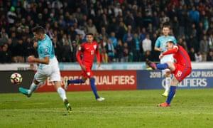 England's Wayne Rooney shoots.