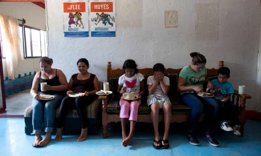 Carmen Gomez, Cynthia Lemus<br>In this Wednesday, June 18, 2014 photo, women and children, including Carmen Gomez, second left, and daughter Cynthia Lemus, third left, watch tv as they eat lunch in the women's section of a shelter providing temporary refuge for Central American migrants traveling north, in Arriaga, Chiapas State, Mexico. Shelters such as the one in Arriaga offer migrants unable to afford a hotel a safe place to rest for a few days and access to regular meals. (AP Photo/Rebecca Blackwell)
