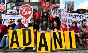 Protestors against the Carmichael coalmine rally outside Adani's headquarters in Brisbane.