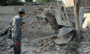 An Afghan police officer looks at a guard post damaged in the 2009 attack at Forward Operating Base Chapman in Khost.