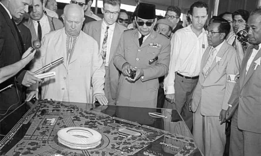 Nikita Khrushchev (in pale suit) and President Sukarno (in cap) inspect the model of the National Stadium in Jakarta, Indonesia, in 1960.