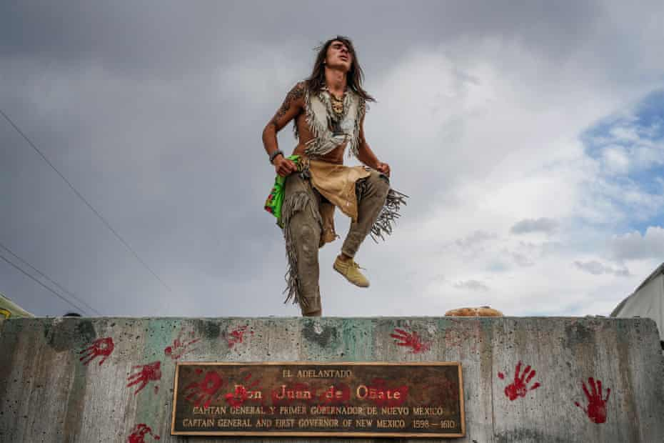 Than Tsídéh, 19, of the Ohkay Owingeh Pueblo dances on the empty platform where a statue of Juan de Oñate was removed.