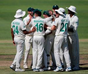 South Africa's Keshav Maharaj (3rdL) celebrates with teammates after the dismissal of England's Joe Denly