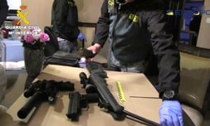 Spanish civil guards confiscating weapons after a drugs raid that involved French and UK police through Europol.