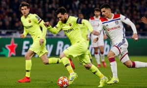 Barcelona's Lionel Messi is chased by Houssem Aouar just before the Lyon player's challenge sends Messi to the grass.