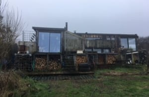 A house made out of old scrap vehicles
