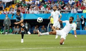 Uruguay's Lucas Torreira shoots at goal under pressure from Saudi Arabia's Abdullah Otayf.