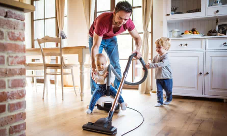 Man with hoover and children