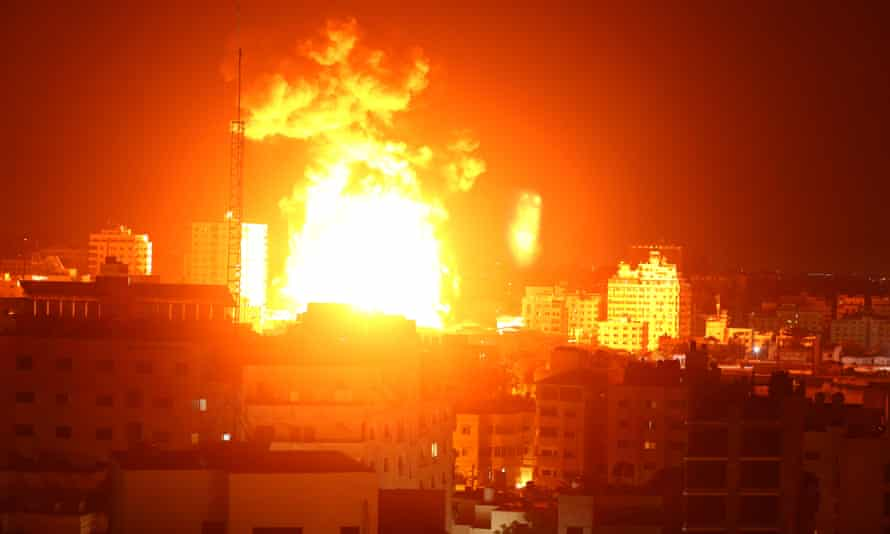 Fire and smoke rise above buildings in Gaza City after Israeli warplanes targeted the Palestinian enclave early on Monday.
