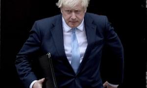 Boris Johnson prepares to speak to the media outside 10 Downing Street.