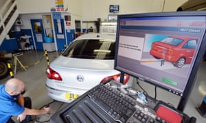 A VW Passat CC car is tested for its exhaust emissions at a testing station