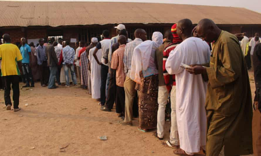 Voters wait in line at a polling station in Bangui