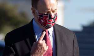 Republican Senator from Alabama Richard Shelby points to his University of Alabama face mask last month in Washington.