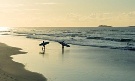 'Not like that!' … surfers at White Rocks Strand, Portrush.