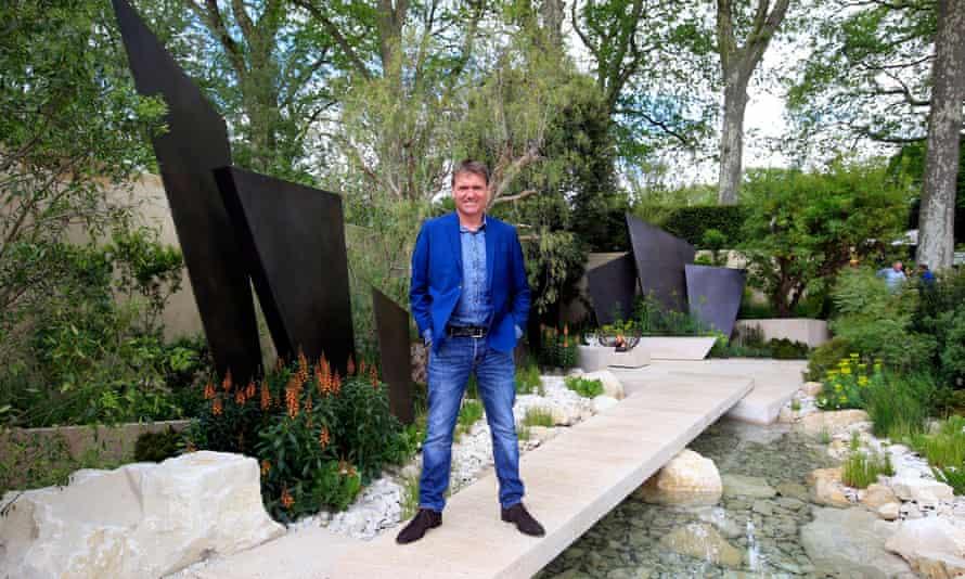 Designer Andy Sturgeon stands in his creation, the Telegraph garden.