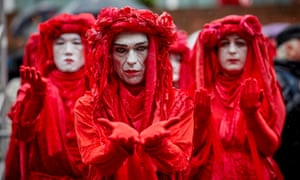 Environment activists clad in red were part of the anniversary commemorations.